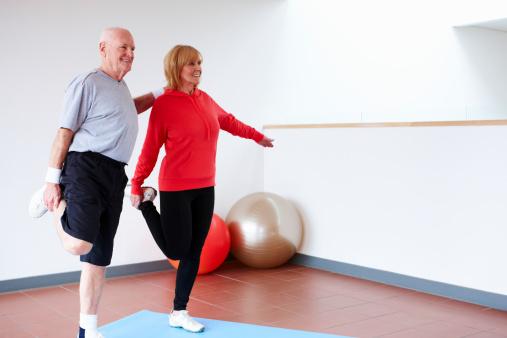 Senior Couple Balancing on One Leg
